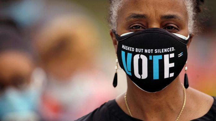 2020-10-27T230410Z_1541707939_RC2BRJ903V13_RTRMADP_3_USA-ELECTION-BLACK-VOTERS